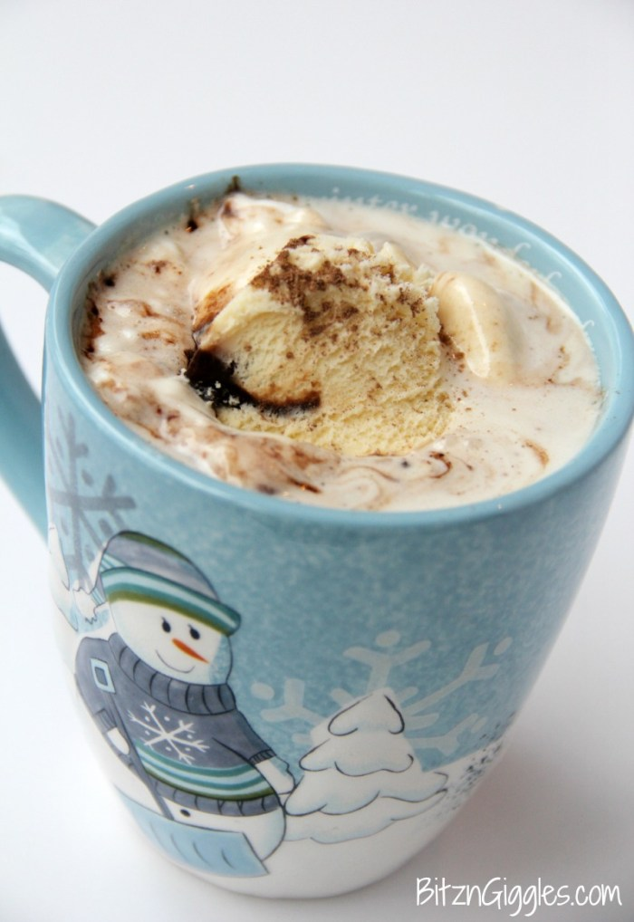 Snowball Hot Chocolate - Creamy and rich white chocolate topped off with a scoop of ice cream and garnished with chocolate.