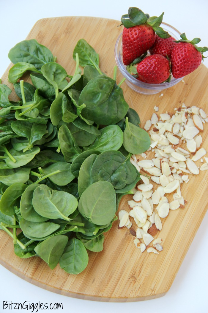 Strawberry Spinach Salad - A delicious, sweet salad with fresh strawberries, spinach and an almond crunch.