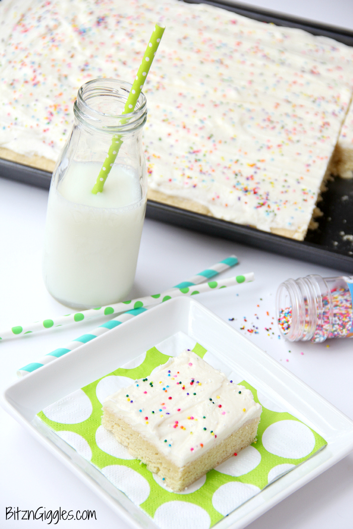 Sugar Cookie Cake Bars - Soft and chewy bars topped with decadent buttercream frosting and colorful sprinkles ~ perfect for a party and makes enough for a crowd!