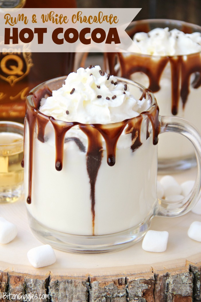 Rum & White Chocolate Hot Cocoa - a heavenly combination of white chocolate, rum, marshmallows, drizzles of chocolate and a big swirl of whipped cream topped with sprinkles is the ultimate fall indulgence!