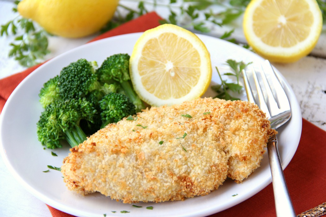 5-Ingredient Air Fryer Lemon Chicken - Chicken tenderloins are dredged in egg and Panko, then air-fried to create a crispy crust. A little salt and squeeze of lemon brings this dish to life!