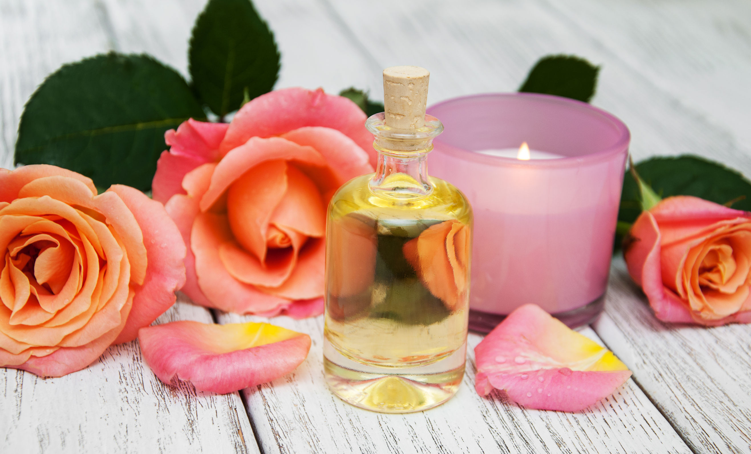 69538167 - spa concept with pink roses on a old wooden background