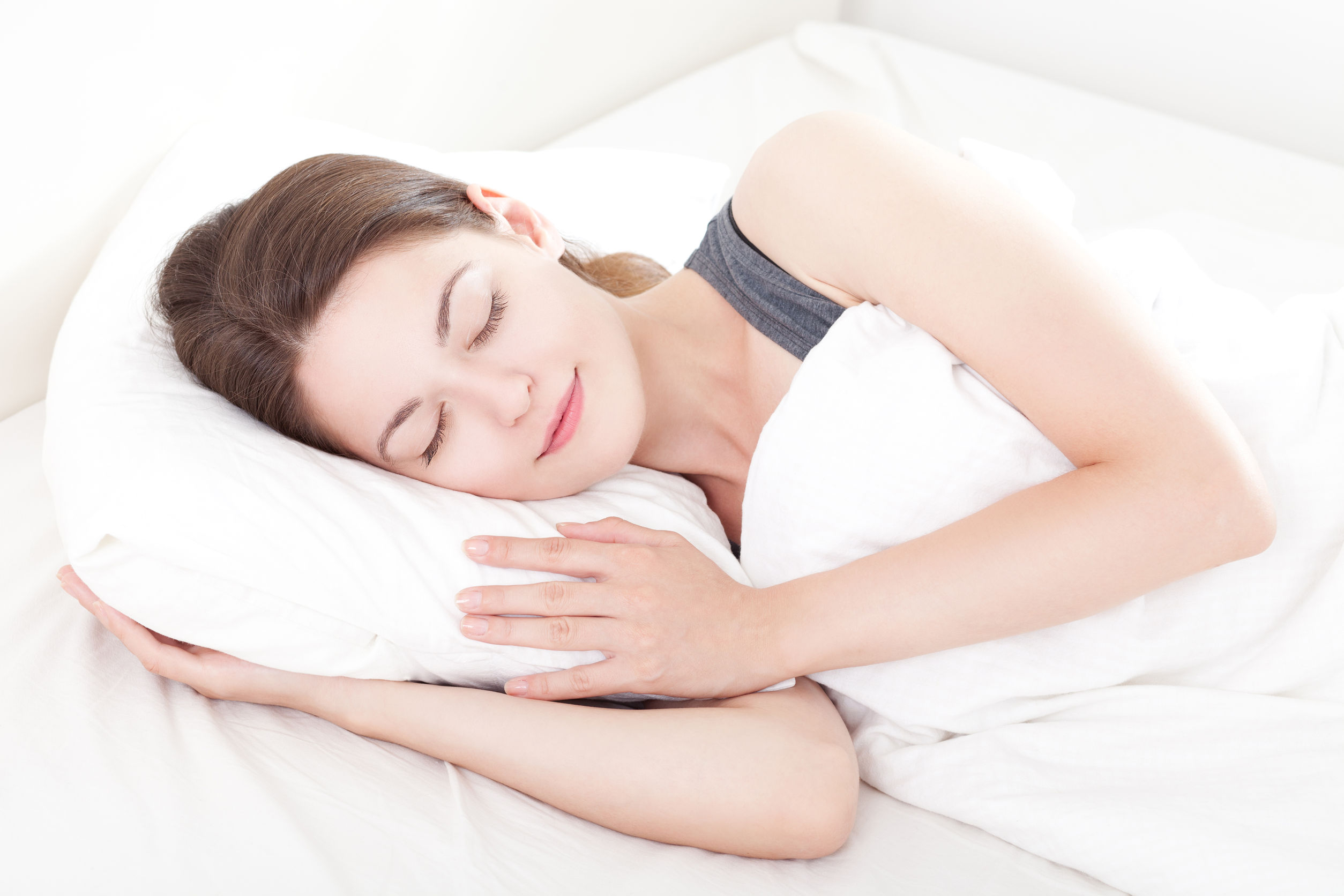 39450868 - beautiful young woman asleep, on white background