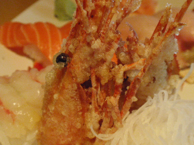 Tony is more adventurous!  Shrimp head!  I don't like the beady eyes!