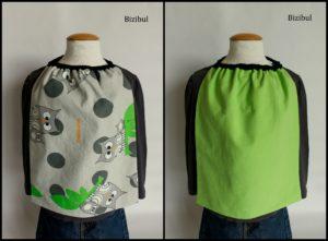la serviette de table élastiquée composée d'un coton imprimé hiboux et d'un coton uni vert anis.