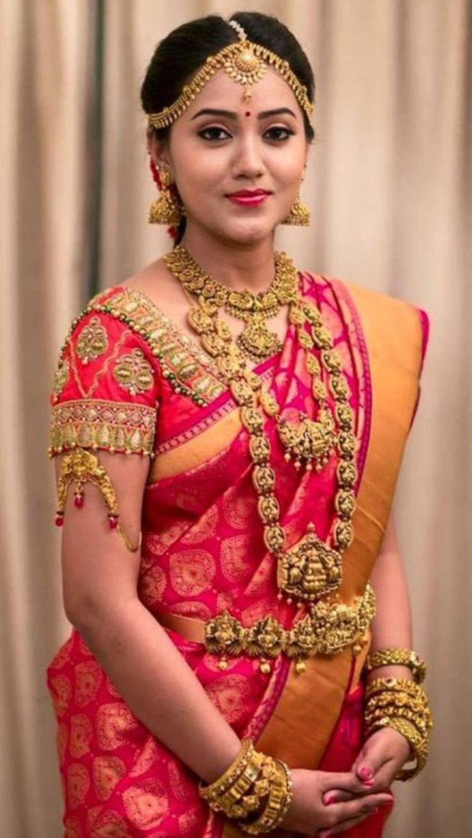 south indian bridal makeup near by green tree | green trends