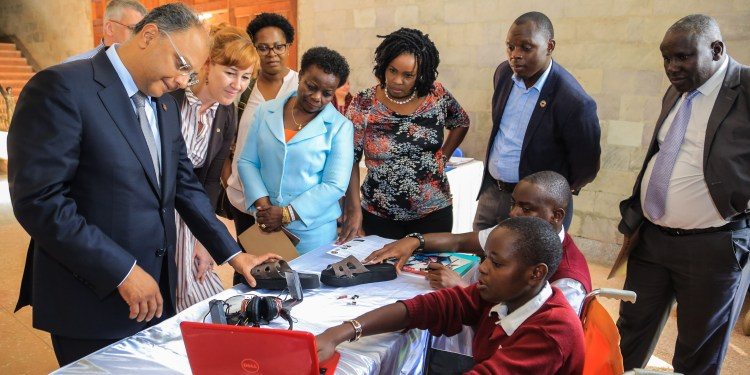 Wilson Kipkorir Meli and Deborah Nyaboke of Joyland secondary school in Kisumu demonstrate their project to YSK Chairman and PS. Kevit Desai, Charge De Affairs at Irish Embassy Lisa Doherty and Safaricom Youth Segments Lead Angela Githuthu during the official launch of YSK boot camp at Moi Girls Nairobi.