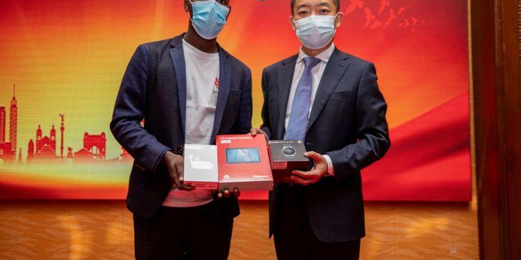 Student getting Huawei prizes - Global ICT Competition - Bizna Kenya