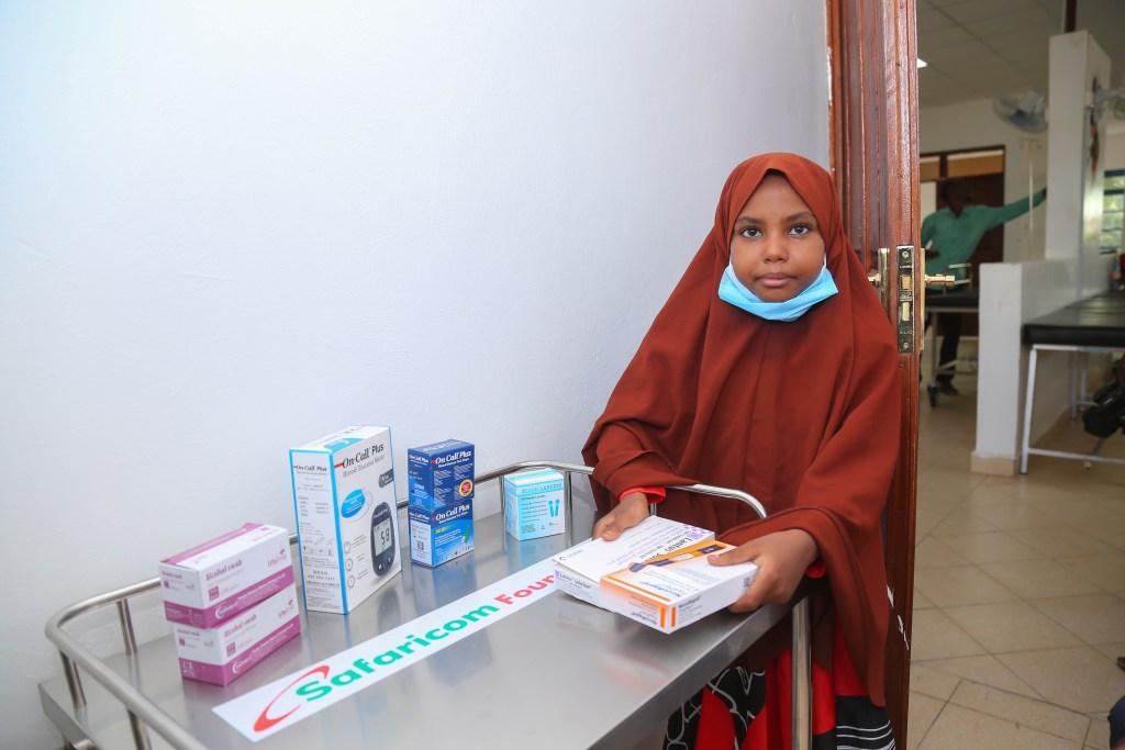 Sambrim Said, with her diabetes kit and medicine donated by Safaricom Foundation - Bizna Kenya