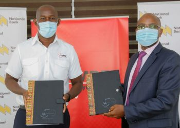 The Managing Director of National Bank of Kenya, Paul Russo (right) and Amref Flying Doctors CEO, Stephen Gitau (left) signing an MOU between NBK and Amref Flying Doctors to provide air evacuation and ground ambulance services for its customers, in case of a medical emergency - Bizna Kenya