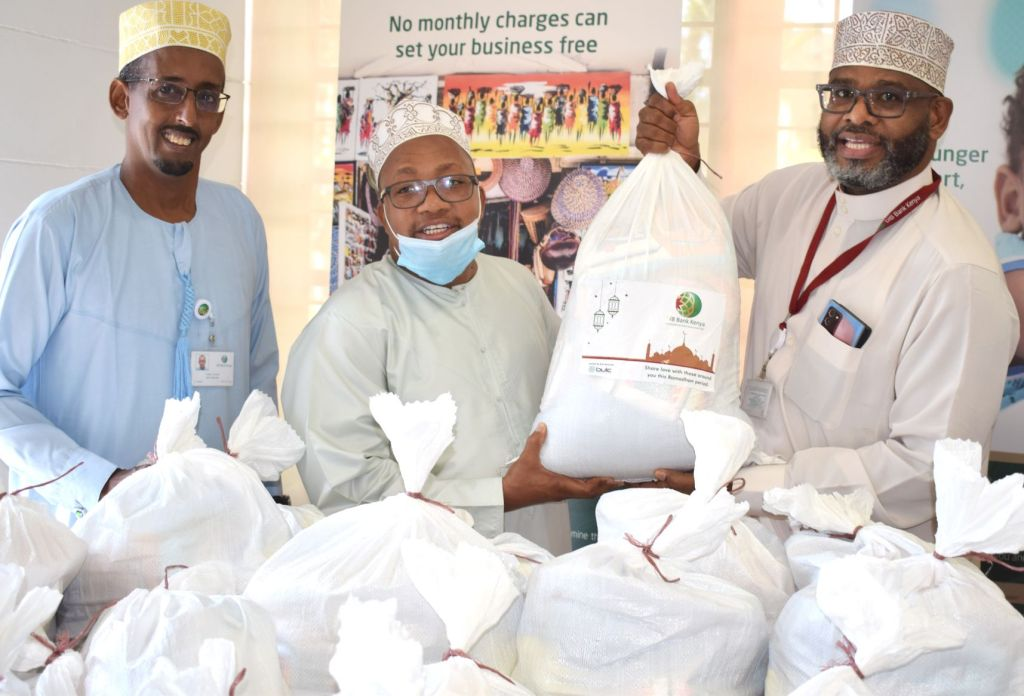 DIB Bank Bondeni branch manager Yassir Abdulkarim and Head of Central Operations Abubakar Ali present care package for distribution to the CEO of the WAQF Commission Dr. Ibrahim Balushi (centre) - Bizna Kenya
