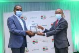 Safaricom CEO, Peter Ndegwa (left), receives an award (Outstanding contribution to the mobile industry) from, GSMA Head of Africa, Wale Goodluck. This was held at the Michael Joseph Centre - Bizna Kenya