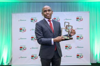 Safaricom CEO, Peter Ndegwa, poses for a photo with the GSMA Outstanding contribution to the mobile industry award - Bizna Kenya