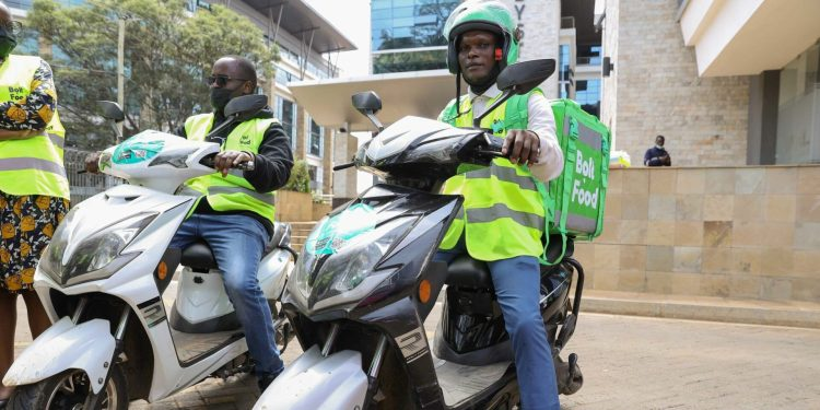 Bolt Food couriers display the e-bikes that have been introduced by Bolt as the company seeks to expand its green transport options in Kenya - Bizna Kenya