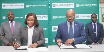 Jacquelyne Waithaka - Director, Corporate and Institutional Banking at Co-op Bank and Peter Waiyaki - Board Chair, Enwealth Financial Services Limited, sign a partnership agreement to launch the Pension-backed Mortgage Loan at Co-op Bank's Property Hub in Nairobi. Looking on are Head of Mortgage Finance at Co-op Bank Chris Chege (extreme left) and Simon Wafubwa, Managing Director, Enwealth Financial Services Limited - Bizna Kenya