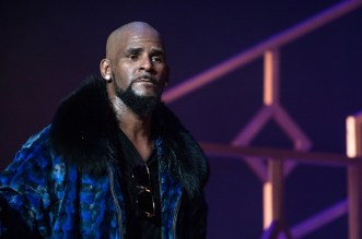 R Kelly Charged with 2 Counts of Prostitution