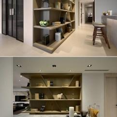 Kitchen Showrooms Table Ideas 倾斜的金属与木纹立板打破书的陈列表情 创造更多灵活的美学摆设 再 再搭佐风格对象 让人文气息蔓延一室