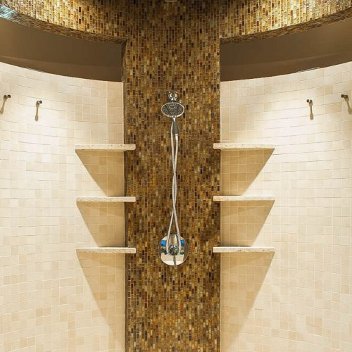 Modern bathroom with a cylindrical glass tile shower