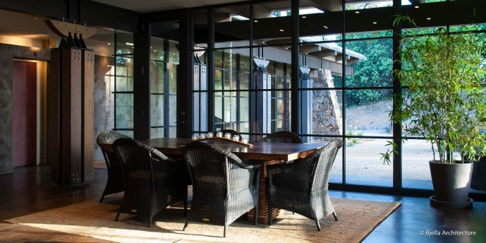 Modern Glass Dining Room with Wicker Chairs