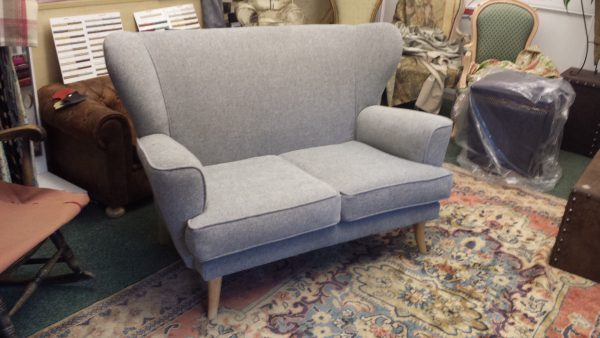Wing two seater sofa.