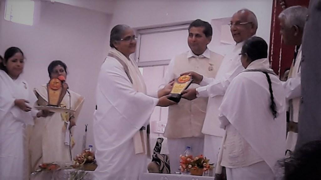 Governor of Tripura Honor BK Kavita with shawl and memento