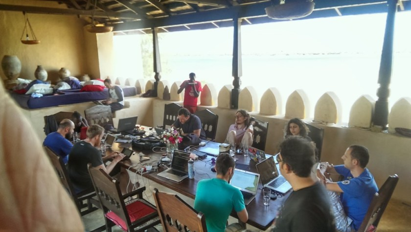 Hackerbeach attendees at the upper dining table