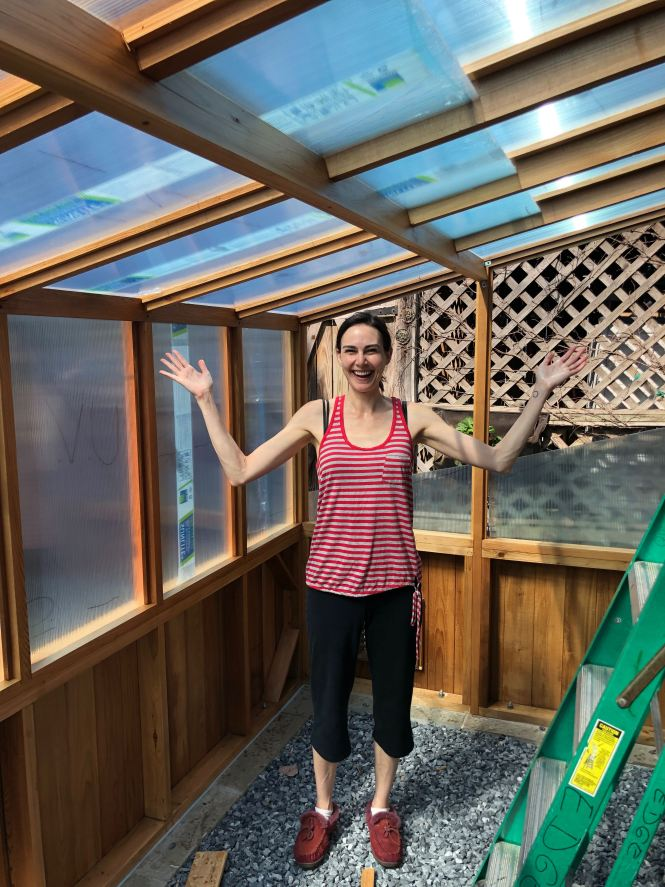Me in my unfinished greenhouse