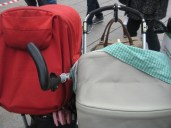 Stroller parking with two sleeping babies.