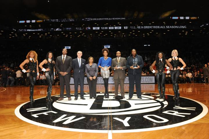 (L to R): Brooklynettes dancers with Ken Thompson, Brooklyn District Attorney; Brett Yormark, CEO of the Brooklyn Nets and Barclays Center; Darlene Abubakar, Senior Director of National Advertising and Marketing Programs for Amtrak; Janine Hausif, CEO and Founder of Around the Way mobile app; Mark Anthony Jenkins, Founder and Chairman of the New York African-American Chamber of Commerce; and Ruth Lovelace, Head Boys Basketball Coach at Boys & Girls High School in Brooklyn. Photo credit: Adam Pantozzi/ Brooklyn Nets
