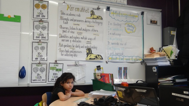 A student sits quietly in a classroom at TFOA Professional Preparatory Charter School