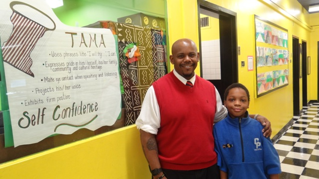 TFOA Professional Preparatory Charter School Founder and Co-Leader Rafiq Kalam Id-Din II with a student