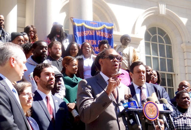 City Councilmember Robert Cornegy with school advocates on the steps of City Hall in support of Cornegy's Audible Alarms Bill