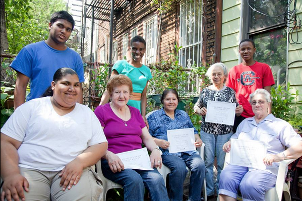 Seniors show their certificates after completing a MAZii Intergenerational Learning Program