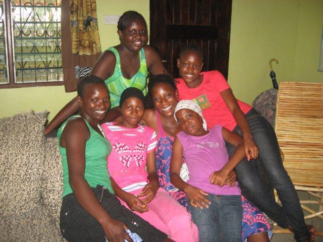 """""""Mama Brittanie"""" with some of her """"daughters"""" she has rescued from sex trafficking"""