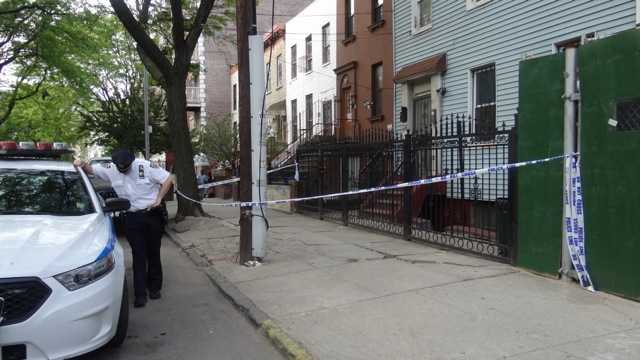 Police tape off house where witness say argument started in front of 219 Spencer Place