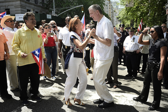 Mayor Bill de Blasio dances with Congresswoman Nydia Velázquez at the Puerto Rican Day Parade on Fifth Avenue on Sunday, June 8, 2014. Credit: Diana Robinson for the Office of Mayor Bill de Blasio