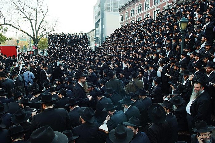 Chabad Sluchim in front of 770 Eastern Parkway who gather from around the globe annually in honor of Rabbi Menachem Shcneerson Photo: Baruch Ezagui