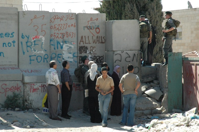 Israeli soldiers and Palestinian residents at a checkpoint on the West Bank Photo: wikipedia.org