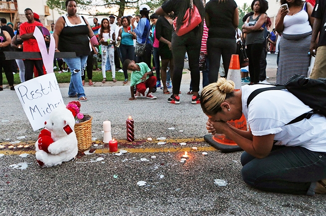 A mourner at the site of Michael Brown's shooting death