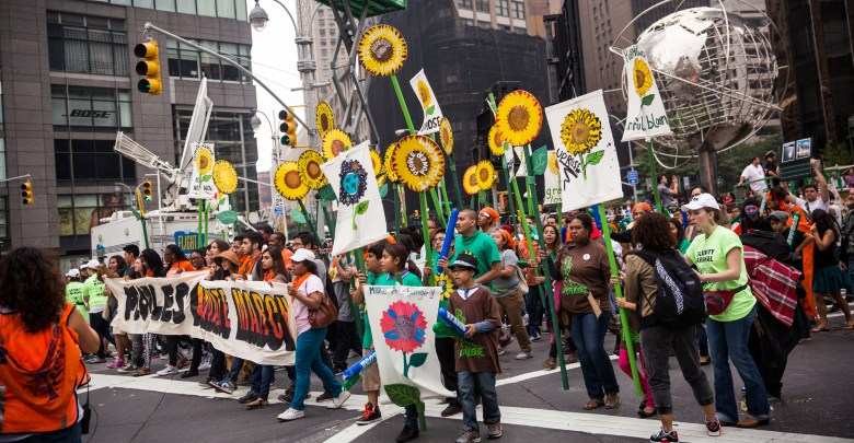 People protest for greater action against climate change during the People's Climate March on September 21, 2014 in New York City. Photo: q13fox.com