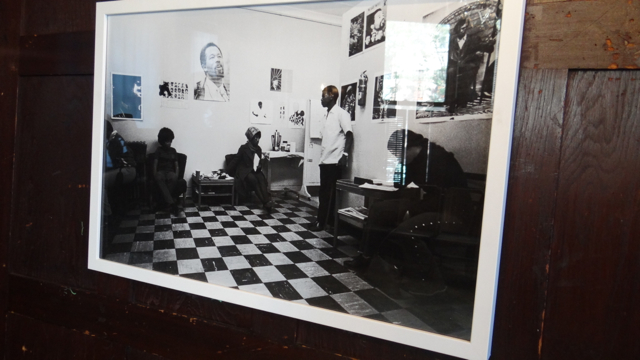 A framed photo of one of the original People's Free Medical Clinics hangs inside of the waiting room area.