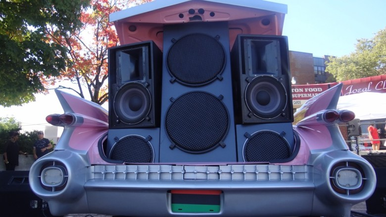 """Pink Cadillac outfitted with speakers broadcasting live """"OJ Radio,"""" part of the exhibit Funk, God, Jazz and Medicine: Black Radical Brooklyn"""