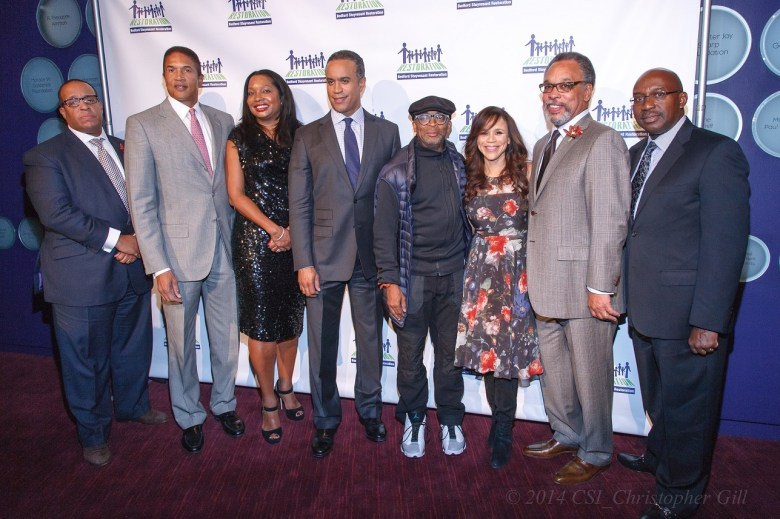 (l to r): Kevin Chavers, Chairman of the Board, Bedford Stuyvesant Restoration Corporation; Christoper Williams and Janice Williams, co-founders, The Williams Capital Group; Maurice DuBois, anchor, CBS 2 News; Spike Lee, film director, producer, writer, actor and community activist; Rosie Perez, actor, author, activist and co-host of ABC's The View; Bruce Gordon, business leader and former NAACP president; Colvin Grannum, President and CEO, Bedford Stuyvesant Restoration Corporation