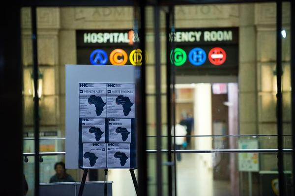 An Ebola Health Alert is posted outside of the entrance of Bellevue Hospital
