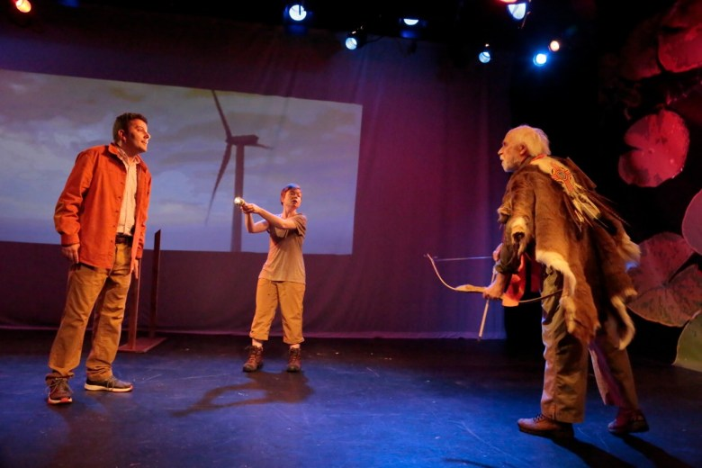 """Alex Tavis as the fossil fuel industry mogul Frank, being fired upon by George Bartenieff as Uncle, an environmentalist, and Kathleen Purcell as Annie: """"The wind turbine works!"""" in """"Extreme Whether"""" Photo: Beatriz Schiller"""