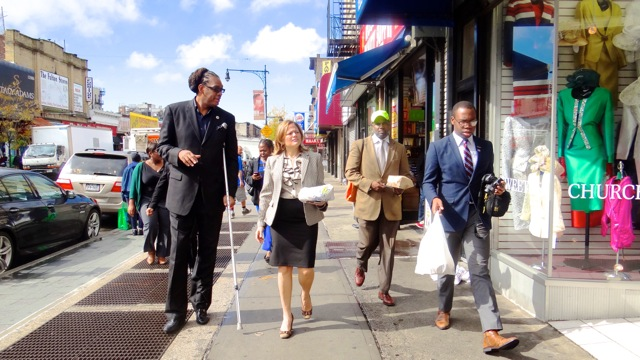 City Council Speaker Melissa Mark-Viverito (second from left) is accompanied by City Councilmember Robert Cornegy, Jr. and Michael Lambert, executive director of the BID for a stroll and tour of Fulton Street