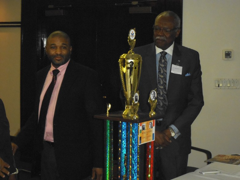 Consul Bernard Legodi of South Africa and Free Holder Board Member of Essex County admire World Leaders Trophy that was unveiled at meet and Greet.