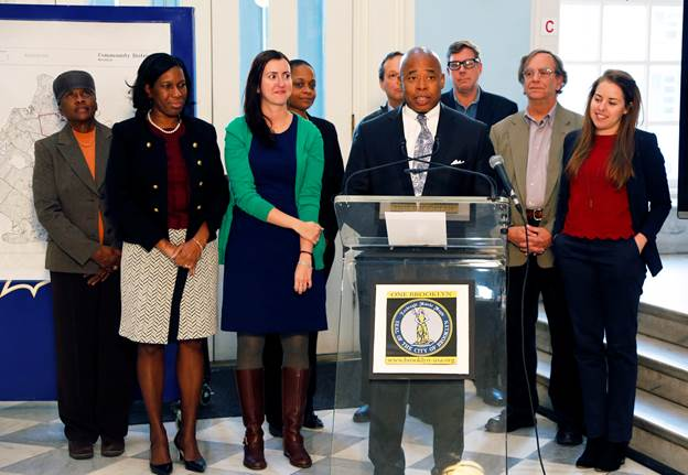 Brooklyn Borough President Eric L. Adams joins educators, community leaders and advocates in the rotunda of Brooklyn Borough Hall to urge teenagers to take advantage of a new state law that now allows them to become members of the City's community boards; he is joined by (from left to right) Brooklyn Community Board 16 Chair Bettie Kollock-Wallace, Brooklyn Borough Hall Chief Program Officer Sandra Chapman, Assembly Member Nily Rozic, Brooklyn Community Board 3 Chair Tremaine Wright, Al Kurland of PAL, Brooklyn Community Board 2 District Manager Robert Perris, Alan Schulman of ATSS/UFT, and Sarah Andes of Generation Citizen. Photo: Kathryn Kirk/Brooklyn BP's Office