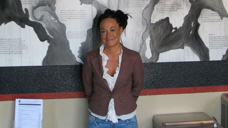Rachel Dolezal, a leader of the Human Rights Education Institute, stands in front of a mural she painted at the institute's offices in Coeur d'Alene, Idaho. Photo: Nicholas K. Geranios/ AP Photo