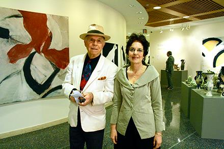 The actor, George Bartenieff, with Karen Malpede near one of Rowland's large abstract paintings at her 2013 retrospective show.